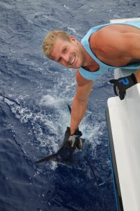 Jonas gets ready to release his marlin