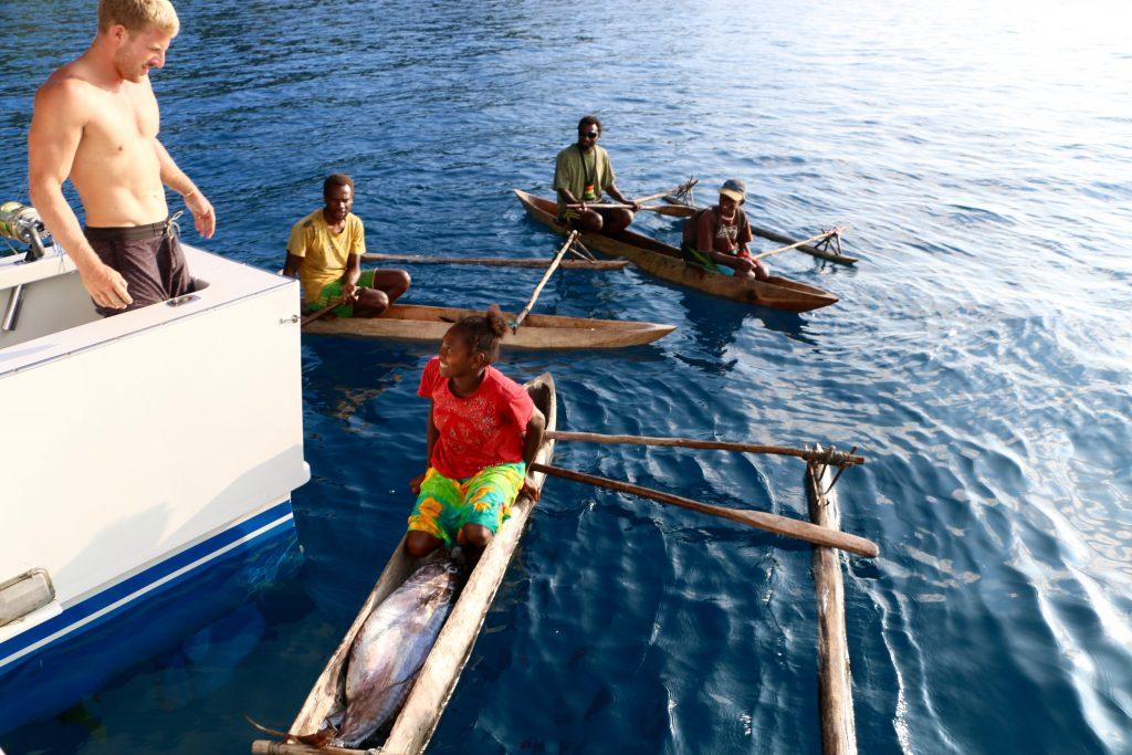 Vanuatu canoe villager accepts fish
